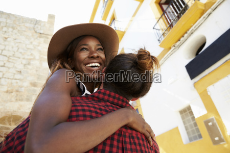 happy couple embracing in the street