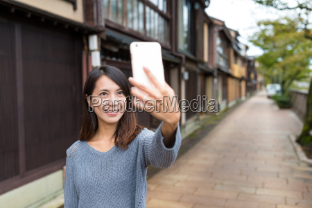 woman taking self photo on mobile