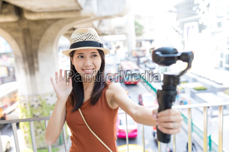 woman holding video stabilizer to take