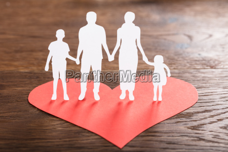 family cut out on red shape