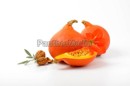 orange pumpkins wtih walnuts sage and