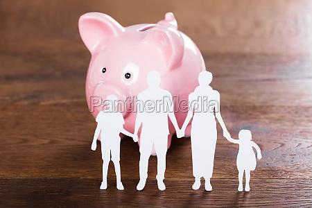 family saving concept on wooden desk