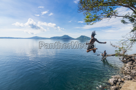 man jumping in the bay of
