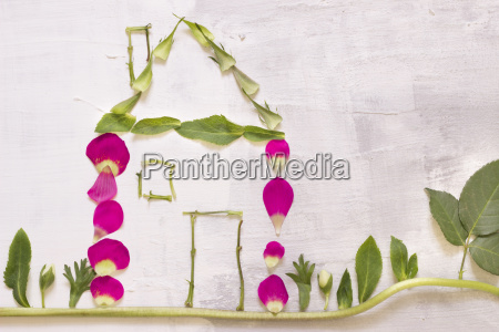 house built of petals leaves and