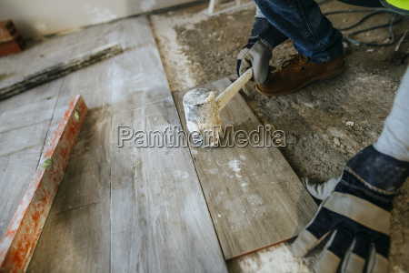 close up of construction worker placing