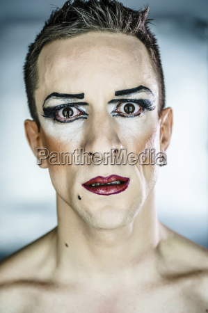 portrait of staring man wearing eye