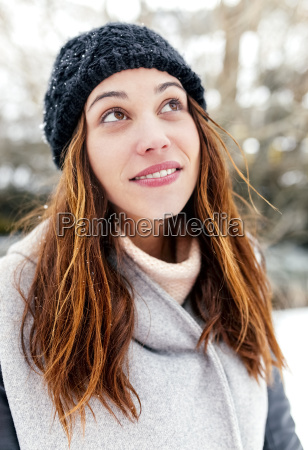 young woman outdoors in winter looking