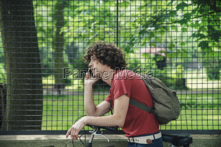young man with bicycle on the