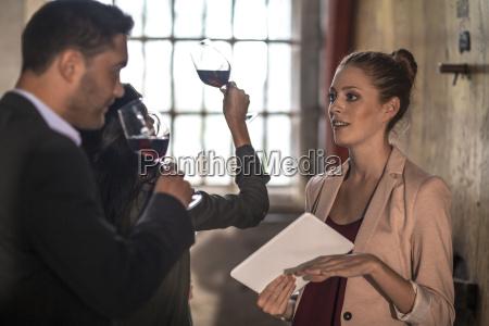 people at a wine tasting at
