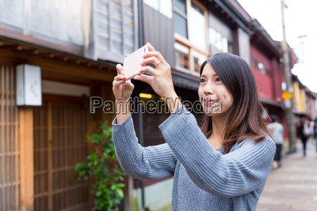 woman taking photo in kanazawa