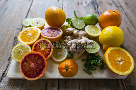 sliced and whole lemons oranges and