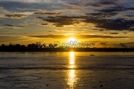 amazon sunset and boat