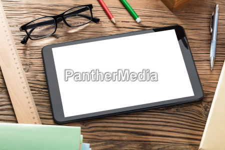 digital tablet on wooden table