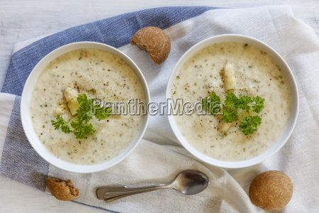 cream of white asparagus soup garnished