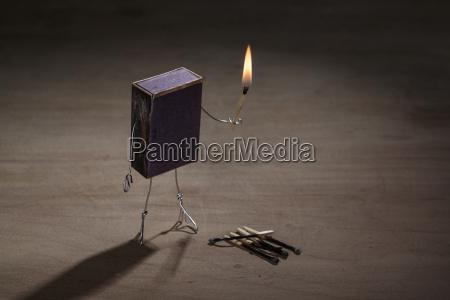 match box manikin with burning match