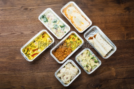 tasty meals in foil containers on