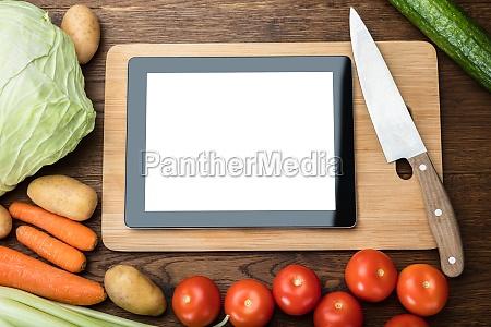 blank digital tablet on chopping board