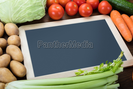 blank slate with fresh vegetables