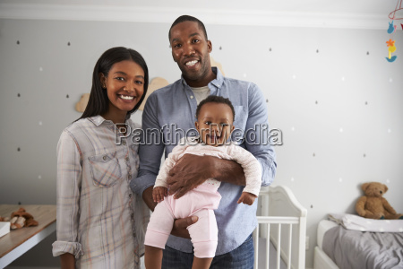 portrait of parents with baby daughter
