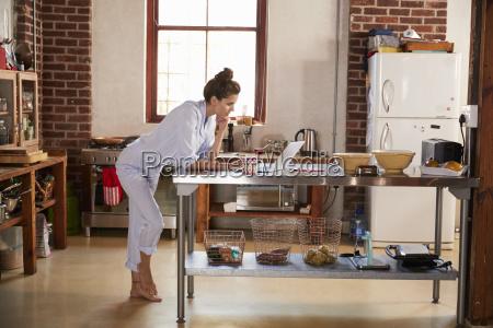 young woman in pyjamas using laptop