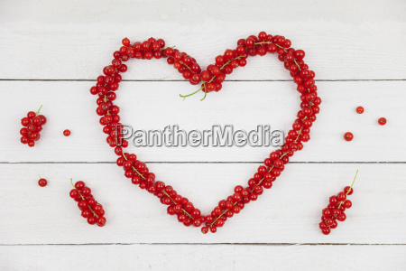 heart shaped of red currants on