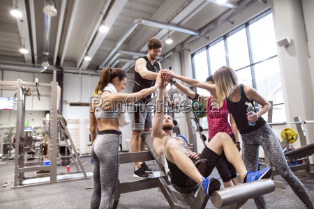 group of people in gym training
