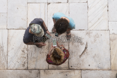 overhead view of three people looking