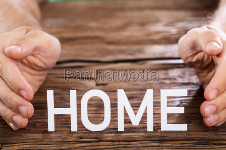 person protecting home word