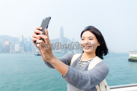 woman taking self image by cellphone