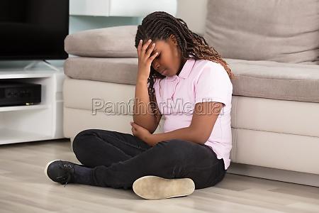 sad girl having headache