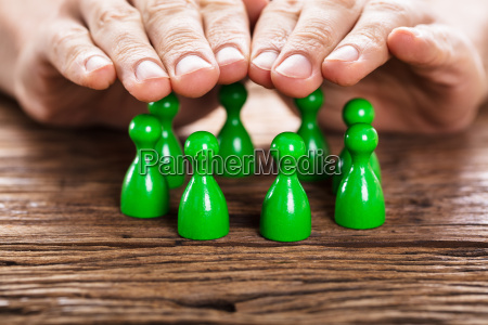 person protecting green persons