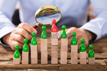 businessman looking the figures with magnifying