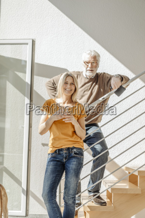 portrait of smiling couple at home