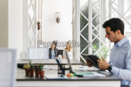 business people talking on balcony while