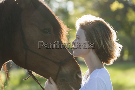 profiles of young woman and horse