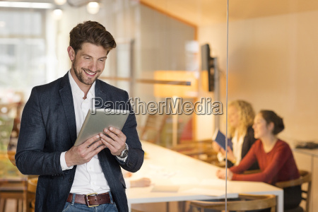 young businessman in office using digital