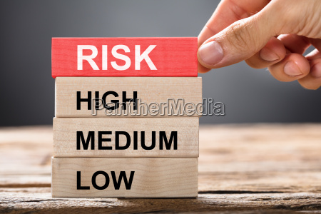 hand building risk concept with wooden