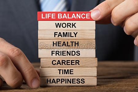 businessman building life balance concept with