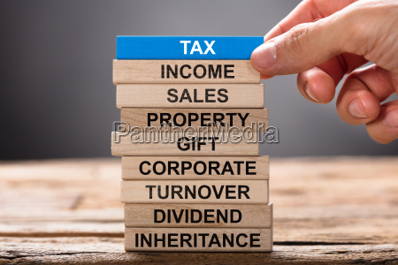 hand building tax concept with wooden