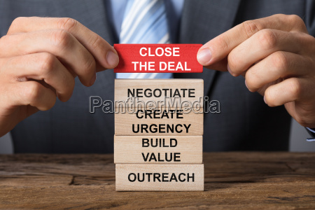 hand building close the deal concept