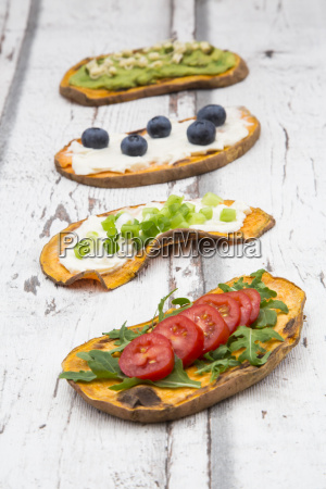 toasted sweet potato slices garnished with