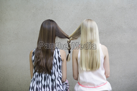 back view of two long haired